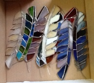 Multi-colored stained glass feathers